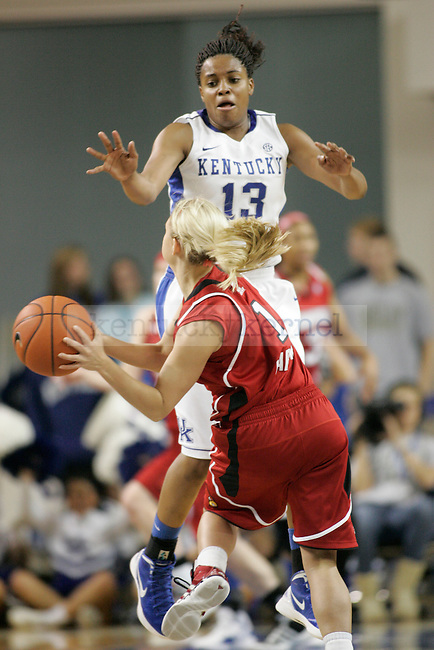 Freshman guard Bria Goss jumps to block a pass from a Lousville player during the first half of UK Hoop's home game against Louisville at Memorial Coliseum in Lexington, Ky., Dec. 4, 2011. Photo by Brandon Goodwin