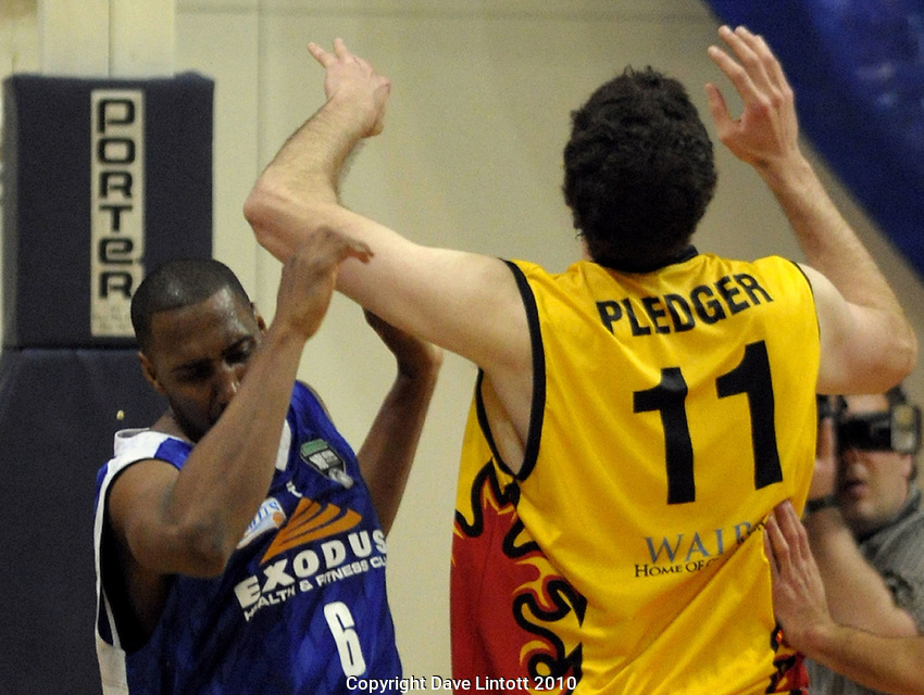 Saints import Erron Maxey's tooth is knocked out by Alex Pledger's elbow. NBL finals game three - Wellington Saints v Waikato Pistons at TSB Bank Arena, Wellington on Thursday, 1 July 2010. Photo: Dave Lintott/lintottphoto.co.nz