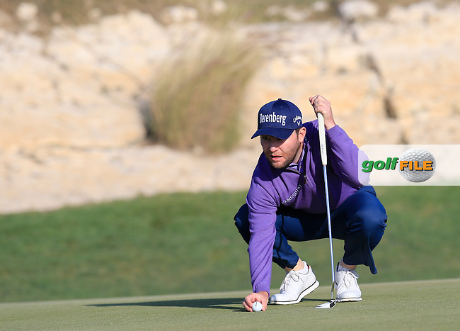Branden Grace (RSA) lines up his putt on the 15th green during Saturday's Final Round of the 2016 Commercial Bank Qatar Masters held at the Doha Golf Club, Doha, Qatar. 30th January 2016.<br /> Picture: Eoin Clarke | Golffile<br /> <br /> <br /> All photos usage must carry mandatory copyright credit (&copy; Golffile | Eoin Clarke)