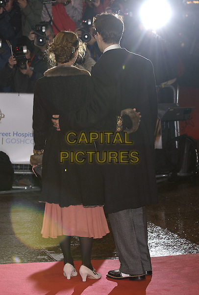 "JOHNNY DEPP & VANESSA PARADIS.""Finding Neverland"" UK charity premiere.Odeon, Leicester Square.London 17 October 2004..half length behind rear back.Ref: PL.www.capitalpictures.com.sales@capitalpictures.com.©Capital Pictures."