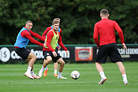 James Chester (left) challenges Ben Davies (right) of Wales during the Wales Training Session at The Vale Resort in Cardiff, Wales, UK. Monday 8 October 2018