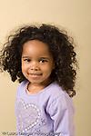 closeup headshot portrait of 3 year old girl vertical