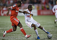 13 June2009:New York Red Bulls midfielder Macoumba Kandji #10 and Toronto FC defender Nana Attakora-Gyan #3 in action during MLS action at BMO Field in Toronto, in a game between the New York Red Bulls and Toronto FC. Toronto FC won 2-1..