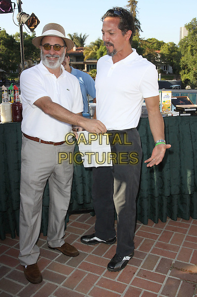 ANDY GARCIA & BENJAMIN BRATT.Launch Of The Ann & George Lopez Foundation At The Third Annual George Lopez Celebrity Golf Classic_ Cocktail Dinner held At The Lakeside Country Club, Toluca Lake, California, USA..May 3rd, 2010.full length white polo shirt grey gray trousers hat sunglasses shades napkin serviette hiding covering wet dirty funny beard facial hair .CAP/ADM/KB.©Kevan Brooks/AdMedia/Capital Pictures.