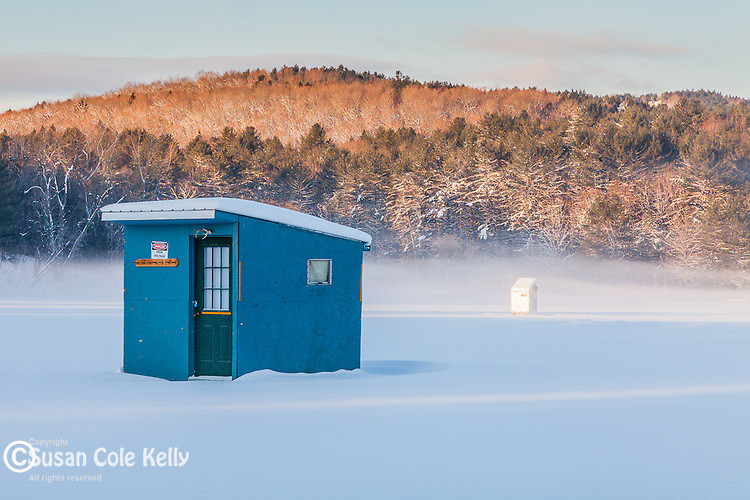 Ice fishing shacks on the Ottaquechee River in Quechee village, Hartford, VT, USA