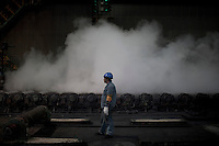 A worker monitors steel making process at a factory of Bao Steel in Shanghai, China on November 9, 2009.