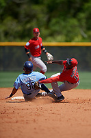 Boston Red Sox second baseman Jecorrah Arnold (17) tags Jonathan Aranda (96) sliding into second base during a Minor League Spring Training game against the Tampa Bay Rays on March 25, 2019 at the Charlotte County Sports Complex in Port Charlotte, Florida.  (Mike Janes/Four Seam Images)