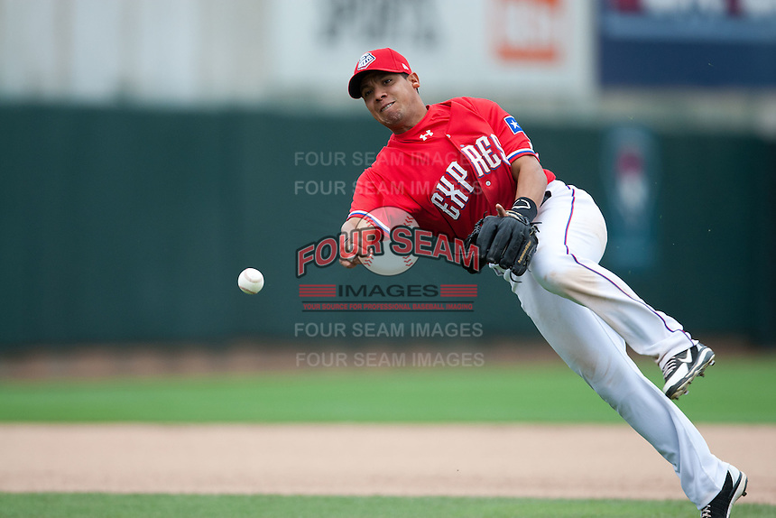 Round Rock Express second baseman Yangervis Solarte #26 throws off-balance to first during the Pacific Coast League baseball game against the Iowa Cubs on April 15, 2012 at the Dell Diamond in Round Rock, Texas. The Express beat the Cubs 11-10 in 13 innings. (Andrew Woolley / Four Seam Images).