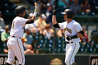 Bradenton Marauders right fielder Kevin Krause (6) is congratulated by Alfredo Reyes (13) after hitting a home run in the bottom of the fourth inning during a game against the Charlotte Stone Crabs on April 9, 2017 at LECOM Park in Bradenton, Florida.  Bradenton defeated Charlotte 5-0.  (Mike Janes/Four Seam Images)