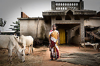 40 year old Laxmi Mohanto outside her newly built house at the Sansilo rehabilitation colony, set up by the Tata steel company for the displaced families in Kalinganagar. She sold six acres of her land for the proposed steel plant and built this house with the money. Tata have been trying to acquire land from villagers in the area in order to build a controversial new 6 million tonne steel plant.