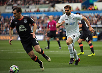 Fernando Llorente of Swansea City (R) chases Leighton Baines of Everton during the Premier League match between Swansea City and Everton at The Liberty Stadium, Swansea, Wales, UK. Saturday 06 May 2017