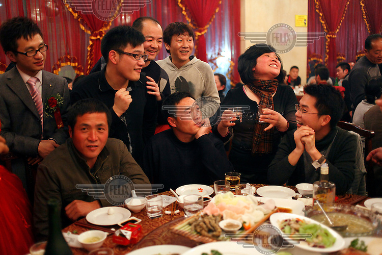 Guests at a wedding banquet eat, drink and enjoy themselves.