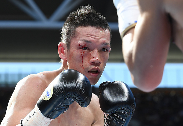 BRIS. Brisbane (Australia), 02/07/2017.- Teiru Kinoshita of Japan in action against against Jerwin Ancajas of the Phillippines (not pictured) during the IBF World Junior Bantamweight Title fight, ahead of the WBO World Welterweight title fight between Australia's Jeff Horn and current title holder Manny Pacquiao of the Philippines at Suncorp Stadium in Brisbane, Queensland, Australia, 02 July 2017. (Filipinas, Japón) EFE/EPA/DAVE HUNT AUSTRALIA AND NEW ZEALAND OUT EDITORIAL USE ONLY