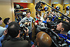 A scrum of media gathers around New York Giants quarterback No. 10 Eli Manning inside the locker room of Quest Diagnostics Training Center in East Rutherford, NJ on Monday, Nov. 16, 2015.<br /> <br /> James Escher