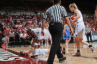 STANFORD, CA - February 12, 2011: Stanford Cardinal's Toni Kokenis is helped up by Chiney Ogwumike after scoring during Stanford's 82-59 victory over UCLA at Maples Pavilion.