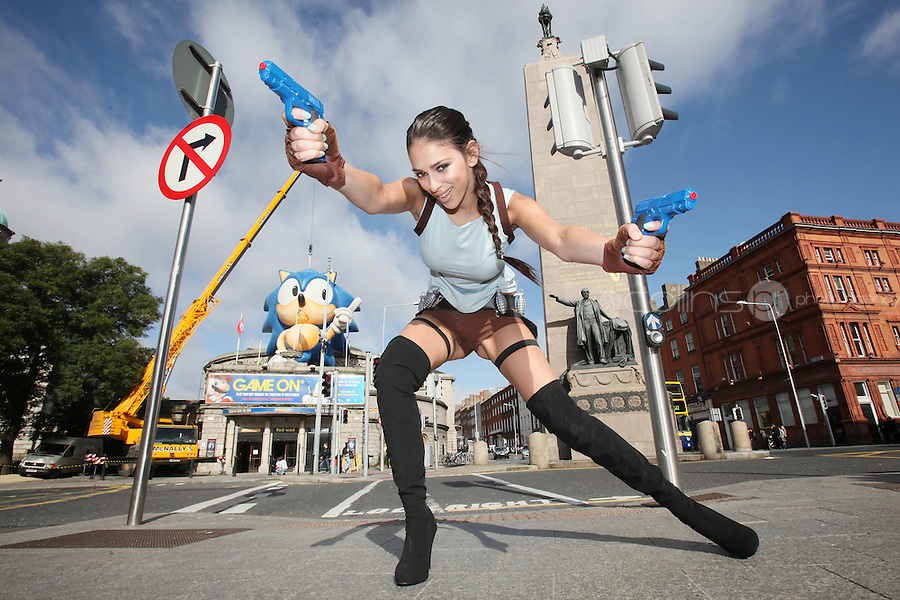 NO REPRO FEE. 20/9/2010. Game On Exhibition. Georgia Salpa dressed as Lara Croft is pictured with a a giant sized Sonic the Hedgehog (measuring a massive 45 ft) for the opening of the Game On Exhibition at Dublin's Ambassador Theatre. Game On is an action packed gaming exhibition with fun for all the family.  Enjoy a totally interactive experience with rare memorabilia and play your way through over 120 playable games from the arcade classics to the latest releases. Now running  at the Ambassador Theatre for a limited run. Tickets from 10 euro including booking fee on sale now  See Ticketmaster.ie and Gameon-Dublin.ie for family and group discounts plus more details. Picture James Horan/Collins Photos