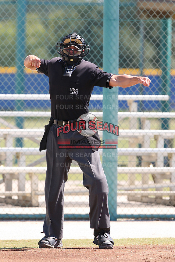 Home plate umpire Mike Terry during a game between the Philadelphia Phiilies and Toronto Blue Jays in an Instructional League game at the Englebert Complex in Dunedin, Florida;  October 4, 2010.  Photo By Mike Janes/Four Seam Images