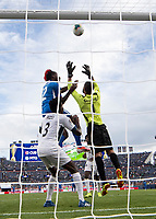 DENVER, CO - JUNE 19: Sandy Sanchez #1 and Johnny Marajo #12 contest the ball in front of the goal as Erick Rizo #3 looks on during a game between Martinique and Cuba at Broncos Stadium on June 19, 2019 in Denver, Colorado.