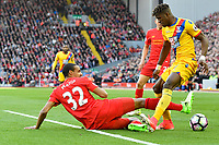 Crystal Palace's Wilfried Zaha is tackled by Liverpool's Joel Matip<br /> <br /> Photographer Terry Donnelly/CameraSport<br /> <br /> The Premier League - Liverpool v Crystal Palace - Sunday 23rd April 2017 - Anfield - Liverpool<br /> <br /> World Copyright &copy; 2017 CameraSport. All rights reserved. 43 Linden Ave. Countesthorpe. Leicester. England. LE8 5PG - Tel: +44 (0) 116 277 4147 - admin@camerasport.com - www.camerasport.com