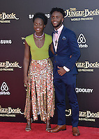 LOS ANGELES, CA. April 4, 2016. Actress Lupita Nyong'o &amp; brother Peter Nyong'o at the world premiere of &quot;The Jungle Book&quot; at the El Capitan Theatre, Hollywood.<br /> Picture: Paul Smith / Featureflash