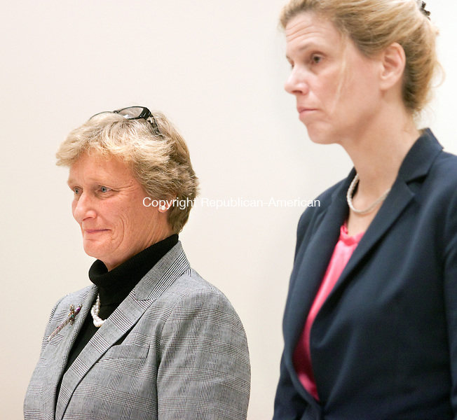WATERBURY- OCTOBER 22 2014 102214DA01- A former principal of Hopeville Elementary School in Waterbury Maria Moulthrop, left, begins her first day in court Wednesday accused of using PTA funds for her own benefit.<br /> Darlene Douty Republican American