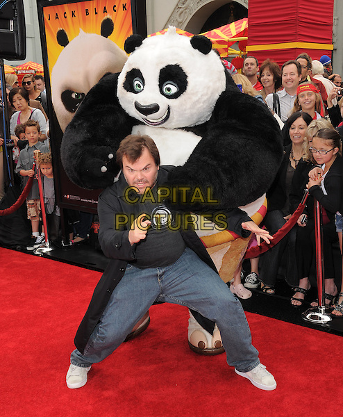 JACK BLACK .at The Dreamworks Animation L.A. Premiere of 'Kung Fu Panda 2' held at The Grauman's Chinese Theatre in Hollywood, California, USA,.May 22nd 2011..full length jeans black coat t-shirt bending funny white trainers    hand finger gesture                                               .CAP/RKE/DVS.©DVS/RockinExposures/Capital Pictures.