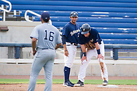 AZL Brewers manager Rafael Neda (28) and Pat McInerney (62) laugh after a stolen base against the AZL Padres 2 on September 2, 2017 at Maryvale Baseball Park in Phoenix, Arizona. AZL Brewers defeated the AZL Padres 2 2-0. (Zachary Lucy/Four Seam Images)
