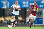 (L) Thiago of Bayern Munich being followed by (R) Zheng Zhi of Guangzhou Evergrande during the Bayern Munich vs Guangzhou Evergrande as part of the Bayern Munich Asian Tour 2015  at the Tianhe Sport Centre on 23 July 2015 in Guangzhou, China. Photo by Aitor Alcalde / Power Sport Images
