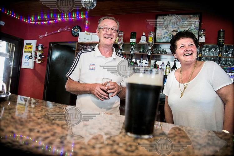 The British couple who run the bar at the The English Speaking Club El Campello. Spain is home to more British ex-pats than anywhere else in the world, mostly concentrated in its Mediterranean regions and there are numerous clubs and organisations catering to this population. The English Speaking Club El Campello, whose president is former RAF and the vice-president a former policeman, organises raffles, dances, trips and games etc and has over 400 members.