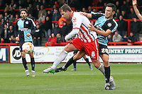 Mark Hughes of Stevenage and Luke O'Nien of Wycombe Wanderers in action during the Sky Bet League 2 match between Stevenage and Wycombe Wanderers at the Lamex Stadium, Stevenage, England on 17 October 2015. Photo by PRiME Media Images.