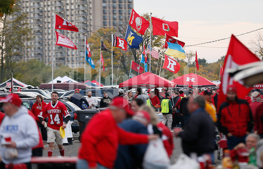 Flags flap in the wind as tailgaters slowly fill the parking lots before the college football game between the Rutgers Scarlet Knights and the Ohio State Buckeyes at High Point Solutions Stadium in Piscataway, NJ, Saturday evening, October 24, 2015. (The Columbus Dispatch / Eamon Queeney)