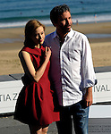 "Canadian actress Sarah Gadon (L) and director Denis Villeneuve (R) pose to promote their film ""Enemy"" during the 61st San Sebastian International Film Festival in Donostia - San Sebastian on September 21, 2013, Basque Country. ( Ander Gillenea / Bostok Photo )"