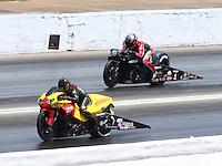 May 16, 2015; Commerce, GA, USA; NHRA pro stock motorcycle rider Angelle Sampey (near lane) races alongside Matt Smith during qualifying for the Southern Nationals at Atlanta Dragway. Mandatory Credit: Mark J. Rebilas-USA TODAY Sports