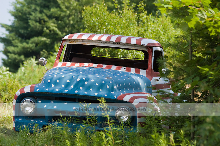 After 9/11, in a show of patriotism, Jay Sawyer and his son of Warren, Maine painted this old car red, white, and blue.