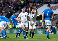George Kruis of England charges down a box kick from Tito Tebaldi of Italy during the Guinness Six Nations match between England and Italy at Twickenham Stadium on March 9th, 2019 in London, United Kingdom. Photo by Liam McAvoy.