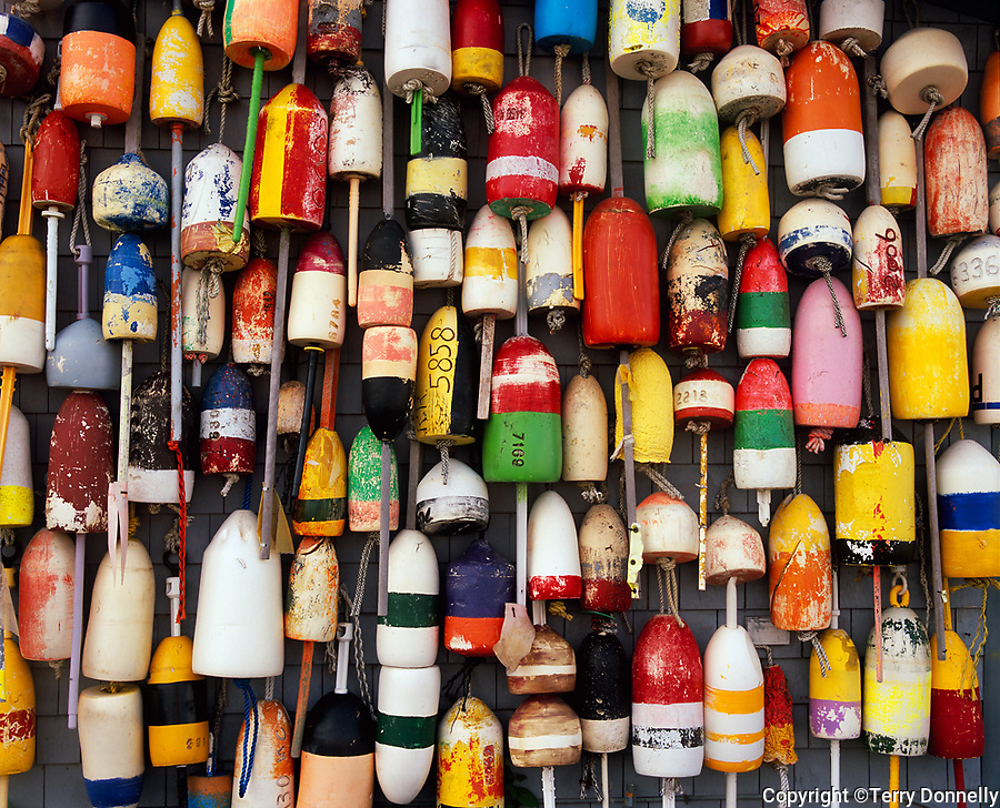 Provincetown, MA<br /> Collection of lobster buoys on a fish house wall