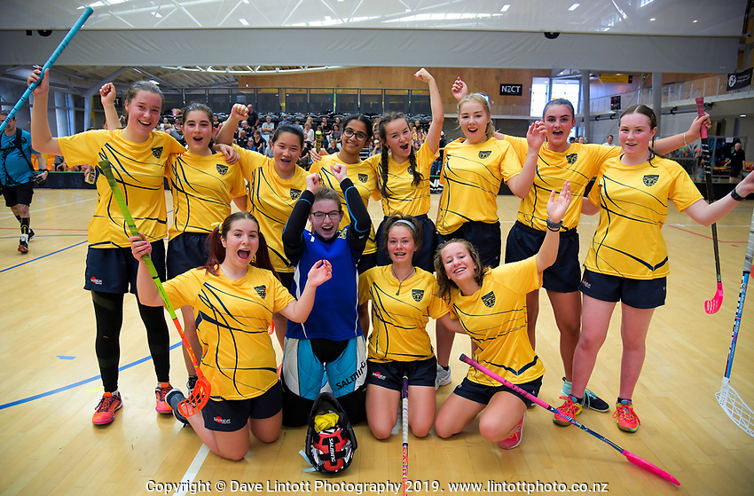 Wellington Girls College players celebrate beating Queen Margaret College in the senior girls' final.  2019 NZ Secondary School Floorball Championships at ASB Sports Centre in Wellington, New Zealand on Sunday, 31 March 2019. Photo: Dave Lintott / lintottphoto.co.nz