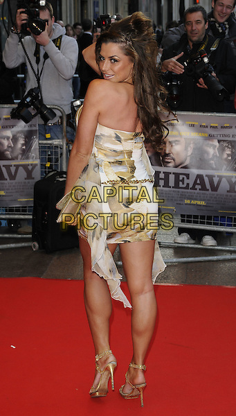 LOUISE GLOVER.World Premiere of 'The Heavy' at the Odeon West End, Leicester Square, London, England, UK..April 15th 2010 .full length white dress beige pattern ruffles gold belt sandals shoes clutch bag looking over shoulder.CAP/CAN.©Can Nguyen/Capital Pictures.