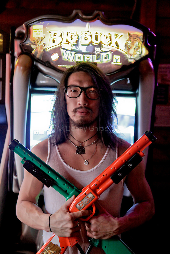 Accomplished Big Buck player Andy Lin, 33, poses for a portrait at The Black Bear Lodge in Manhattan, which hosted an official Big Buck Party on Thursday April, 28, 2011. Fans of the popular hunting arcade game were invited to test their skill against other Big Buck Hunter fans to compete for prizes, enter to win raffle merchandise and meet Big Buck Girls...Danny Ghitis for The New York Times