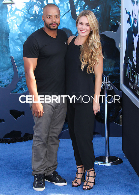 HOLLYWOOD, LOS ANGELES, CA, USA - MAY 28: Donald Faison, Cacee Cobb at the World Premiere Of Disney's 'Maleficent' held at the El Capitan Theatre on May 28, 2014 in Hollywood, Los Angeles, California, United States. (Photo by Xavier Collin/Celebrity Monitor)
