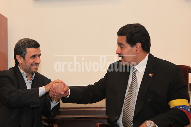 Venezuelan Vice-President Nicolas Maduro (R) and Iran's President Mahmoud Ahmadinejad during the service l for late President Hugo Chavez at the Military Academy in Caracas