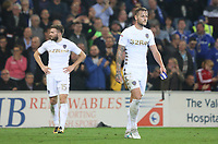 Liam Cooper of Leeds United leaves the field after receiving a red card during the Sky Bet Championship match between Cardiff City and Leeds United at The Cardiff City Stadium, Cardiff, Wales, UK. Tuesday 26 September 2017