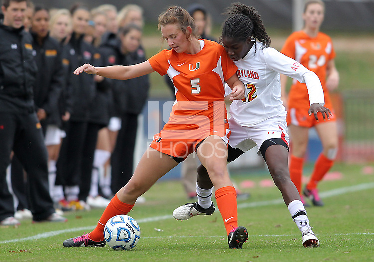 COLLEGE PARK, MD - OCTOBER 28, 2012:  Shade Pratt (22) of the University of Maryland comes up behind Ashley Flinn (5) of Miami during an ACC  women's tournament 1st. round match at Ludwig Field in College Park, MD. on October 28. Maryland won 2-1 on a golden goal in extra time.