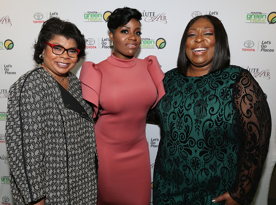Journalist April Ryan left, Soul Solidarity Award Honoree Fantasia Barrino-Tyalor and host Loni Love attend the Salute Her Awards sponsored by Toyota and AARP in Charlotte.