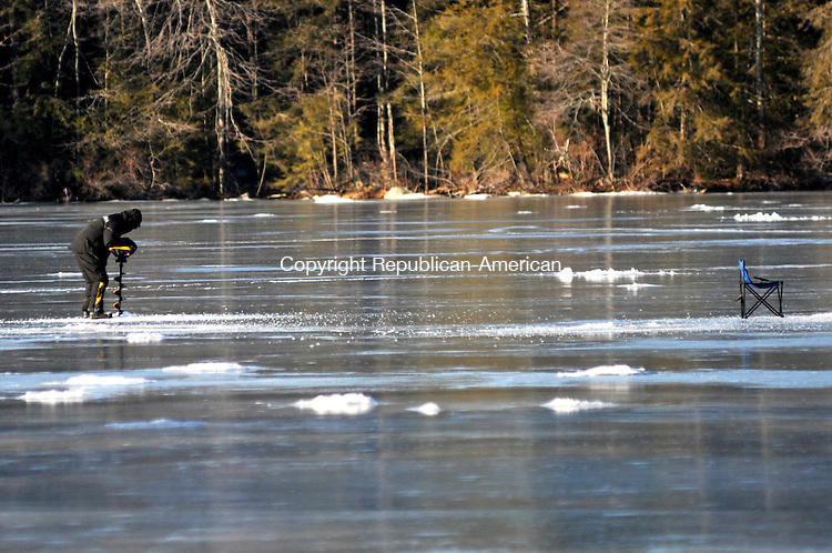 TORRINGTON, CT, 23 JAN 15 - Phil Kozlak, of Torrington, uses a gasoline-powered ice auger to drill through 8 to 10-inch thick ice on Burr Pond to ice fish Friday afternoon. The ice conditions have been optimal for ice fishermen this winter.   Alec Johnson/ Republican-American