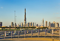 Dubai.  Skyline of the Downtown Dubai Development with the Burj Dubai and Financial Centre, seen across busy urban highway and intersection. .