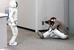 A photographer takes a shot of Honda's Asimo humanoid robot in Tokyo.