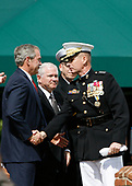 United States President George W. Bush shakes hands with the out-going Chairman of the Joint Chiefs of Staff, US Marine Corps General Peter Pace as he participates in an Armed Forces Change of Command ceremony and official Hail and Farewell tribute in honor for Pace and in-coming Chairman of the Joint Chiefs of Staff US Navy Admiral Michael Mullen at Fort Myer, Virginia on October 1, 2007.  US Secretary of Defense Robert Gates looks on from center.<br /> Credit: Aude Guerrucci / Pool via CNP