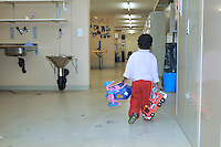 bambino somalo e i giocattoli,  nel centro per asilanti, richiedenti asilo politico,in un ex bunker a Biasca, Canton Ticino, Svizzera.
