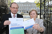 NO REPRO FEE. 7/10/2010. ALZHEIMER SOCIETY PRE-BUDGET SUBMISSION.  Alzheimer Society of Ireland CEO Maurice O'Connell and carer Marjorie Dowling from Dublin who looks after her husband Christopher. They took to the gates of the Dail during the launch of the charity's Pre-Budget Submission to call on the Government to help  the tens of thousands of people living with dementia in Ireland and their carers. The Alzheimer Society of Ireland has warned the Government that further funding cuts to its services in the coming Budget will see some of the 44,000 people living with dementia and their 50,000 carers left without even basic support though community services. The charity made its call at the launch of its Pre-Budget Submission 2011 as it revealed that many carers are now at crisis point as figures show waiting lists for dementia services have shot up by 33% in the last year.  Picture James Horan/Collins Photos